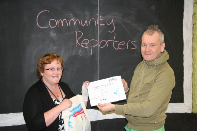 Cath Miller receiving her certificate from David Kay of People's Voice Media